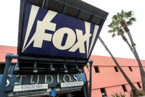 A sign is pictured at a vehicle entrance to Fox Studios in Los Angeles, Californ...