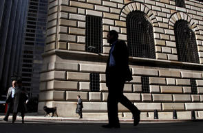 Pedestrians walk past the Federal Reserve Bank of New York in New York.