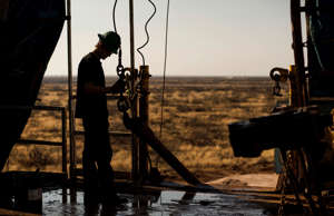 Oil worker outside of Midland, Texas.