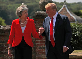 Britain's Prime Minister Theresa May and U.S. President Donald Trump walk to a j...