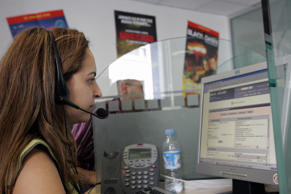 Rabat, MOROCCO:  A Moroccan agent is pictured at a call center in Rabat 14 June ...