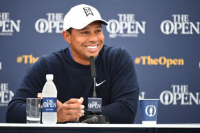 US golfer Tiger Woods smiles as he speaks to members of the media during a press...