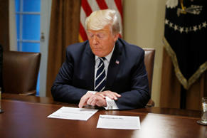 Caption: U.S. President Donald Trump reads from prepared remarks as he speaks ab...
