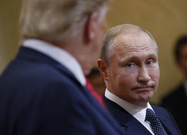 U.S. President Donald Trump, left, and Russian President Vladimir Putin, right, ...