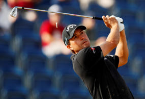 Kevin Kisner of the US putts on the 18th green during the first round of the Bri...