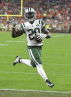 New York Jets running back Isaiah Crowell runs into the end zone for a 7-yard to...