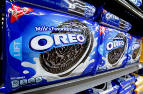 Packages of Nabisco Oreo cookies line a shelf in a market in Pittsburgh, Wednesd...