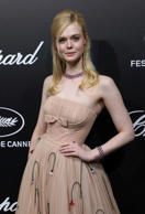 Elle Fanning Wore a Corset Dress so Tight She Fainted— Here's Why Waist Cinchers...