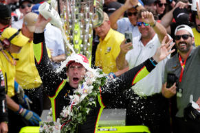 Simon Pagenaud, of France, celebrates after winning the Indianapolis 500 IndyCar...