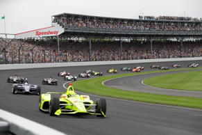 Simon Pagenaud, of France, leads the field through the first turn on the start o...