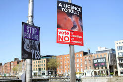 In this photo taken on May 17, 2018, pro and anti-abortion poster's on lampposts...