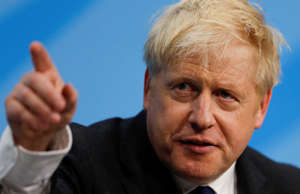 Boris Johnson, a leadership candidate for Britain's Conservative Party, gestures...