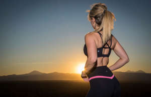 Oregon, Deschutes County, Bend, sunset with fitness model. (Photo by Prisma Bild...