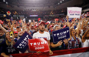 Supporters rally as President Donald Trump speaks at a campaign rally, Thursday,...