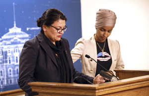 Rep. Ilhan Omar, D-Minn., right, consoles and Rep. Rashida Tlaib, D-Mich., as Tl...