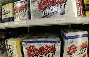 FILE - This May 7, 2007 file photo shows boxes of Coors Light and Coors beer in ...
