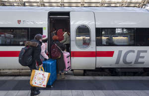 FRANKFURT, GERMANY - DECEMBER 10: Passengers board a ICE train at central statio...