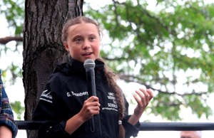 Greta Thunberg, a 16-year-old Swedish climate activist, speaks in front of a cro...