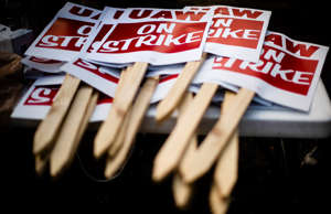 UAW signs are stacked during a demonstration outside a General Motors facility i...