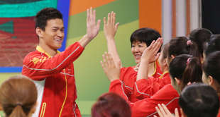 China's swimmer Sun Yang (Left), Chinese women's volleyball team coach Lang Ping...