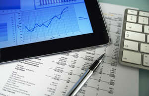 Tablet with graph and financial data.