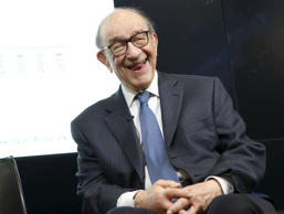 Former Federal Reserve Chair Alan Greenspan smiles at a Brookings Institution fo...