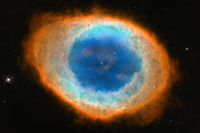 This image shows the dramatic shape and color of the Ring Nebula, otherwise know...