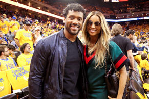 Russell Wilson and Singer, Ciara pose for a photo before the 2016 NBA Finals Gam...