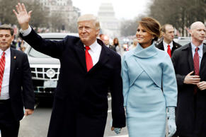 U.S. President Donald Trump waves to supporters as he walks the parade route wit...