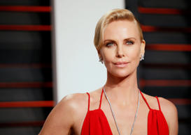Actress Charlize Theron arrives at the Vanity Fair Oscar Party in Beverly Hills,...