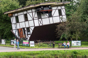 Pedestrians walk past an upside down house in a park in Kaliningrad on September...