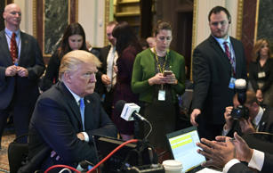 President Donald Trump sits for a radio interview in the Eisenhower Executive Of...