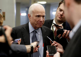 Senator John McCain (R-AZ) speaks to reporters as he arrives for a vote on Capit...