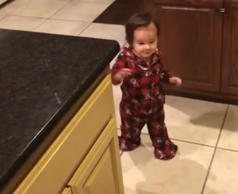 Baby enters kitchen after hearing can of whipped cream