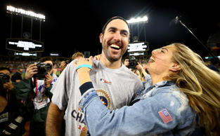 Justin Verlander of the Astros celebrates with fiancee Kate Upton after the Astr...