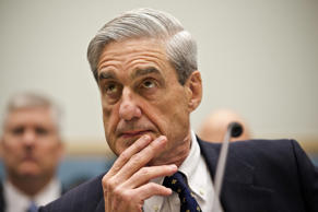 FBI Director Robert Mueller listens as he testifies on Capitol Hill in Washingto...