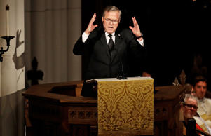 Former Florida Governor Jeb Bush speaks during the eulogy at funeral service for...