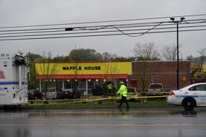 Metro Davidson County Police inspect the scene of a fatal shooting at a Waffle H...