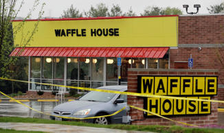 Police tape blocks off a Waffle House restaurant Sunday, April 22, 2018, in Nash...