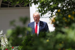 U.S. President Donald Trump walks through the Rose Garden as he prepares to welc...