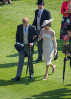 Britain's Prince Harry and his wife Meghan, Duchess of Sussex attend a garden pa...