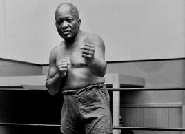 FILE - In this 1932 file photo, boxer Jack Johnson, the first black world heavyw...