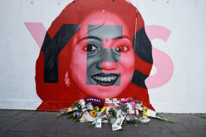 Flowers are left at the foot of a new mural of Savita Halappanavar put up on the...
