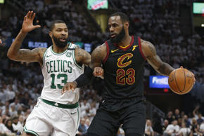 Cleveland Cavaliers' LeBron James (23) drives against Boston Celtics' Marcus Mor...