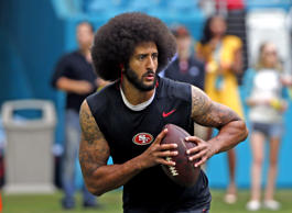 Colin Kaepernick #7 of the San Francisco 49ers runs with the ball prior to the g...