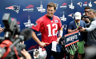 FOXBOROUGH, MA - JUNE 7: New England Patriots quarterback Tom Brady speaks to th...
