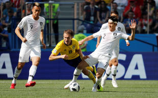 Switzerland's Valon Behrami in action with Brazil's Philippe Coutinho