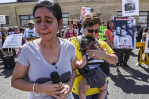 Sharon Chajon whose husband is a detained immigrant cries while people participa...
