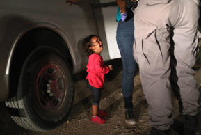 A 2-year-old Honduran girl cried as her mother was searched near the U.S.-Mexico...