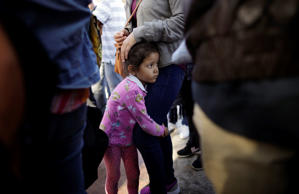 MCALLEN, TX - JUNE 12: A two-year-old Honduran asylum seeker cries as her mother...